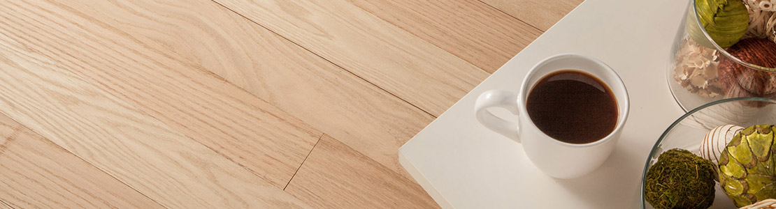 Laying unfinished hardwood floors and finishing them after installation helps maintain the wood's natural characteristics